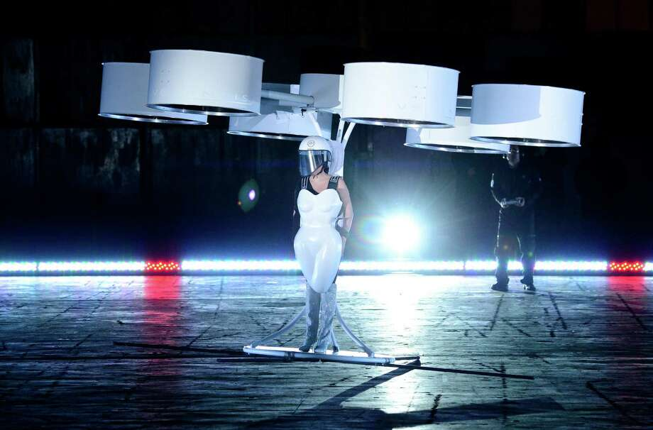 "Lady Gaga demonstrates the Volantis transport prototype ""flying dress"" designed by TechHaus - Studio XO during the ARTPOP album release and artRave event at the Brooklyn Navy Yard on Sunday, Nov. 10, 2013 in New York City. (Photo by Evan Agostini/Invision/AP) ORG XMIT: NYEA108 Photo: Evan Agostini, AP / Invision"