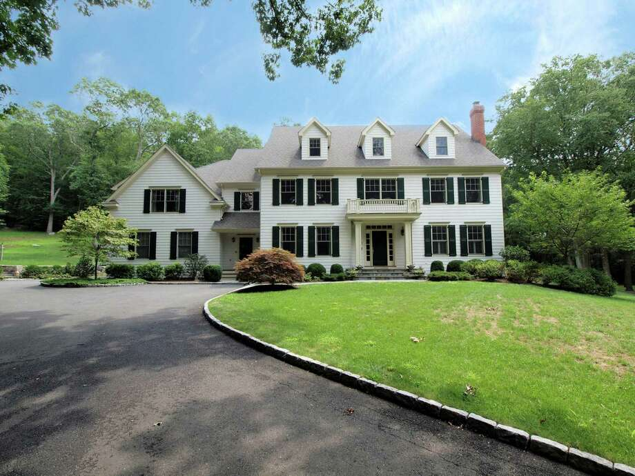 The Colonial at 71 Hickok Road in New Canaan has 15 rooms spread over more than 6,000 square feet on 3 acres of property. It is on the market for $2,399,000. Photo: Contributed Photo, Contributed / New Canaan News Contributed