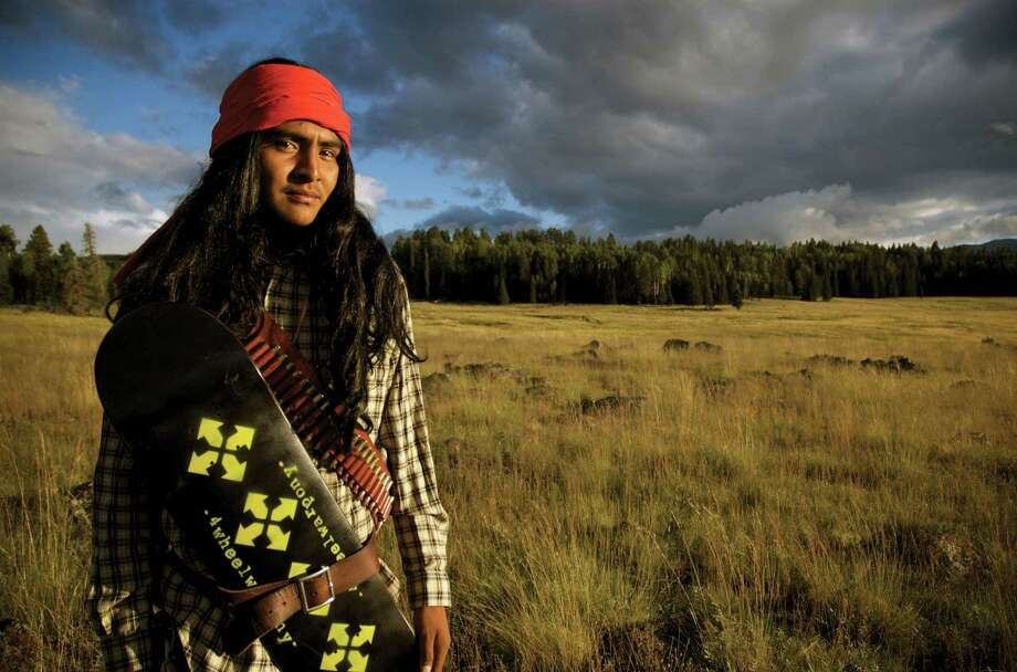 4-Wheel Warpony skater Lee Nash with a skate deck tucked into his belt. The 4-Wheel Warpony skate team was founded by filmmaker Dustinn Craig, who is White Mountain Apache and Navajo. Photo: Smithsonian's National Museum Of