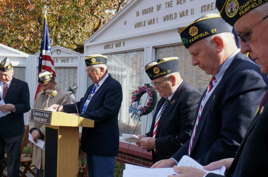 Veterans gather at the Honor Roll in front of Old Town Hall Monday for the annual Veterans Day ceremony. Photo: Genevieve Reilly / Fairfield Citizen
