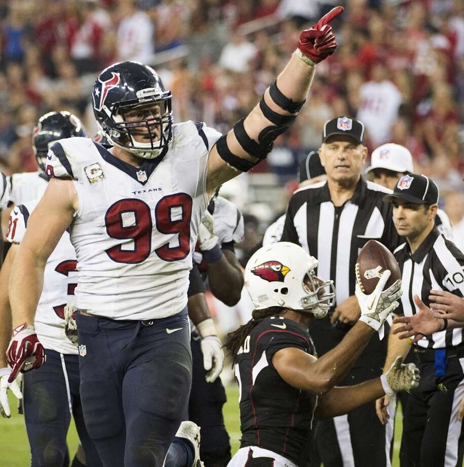 Texans defensive end J.J. Watt signals after forcing a turnover against the Cardinals. Photo: Smiley N. Pool, Houston Chronicle