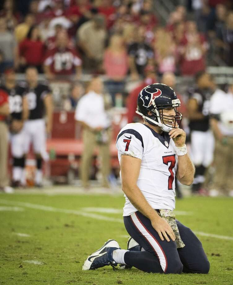 Texans quarterback Case Keenum is slow to get up after throwing an incomplete pass against the Cardinals. Photo: Smiley N. Pool, Houston Chronicle