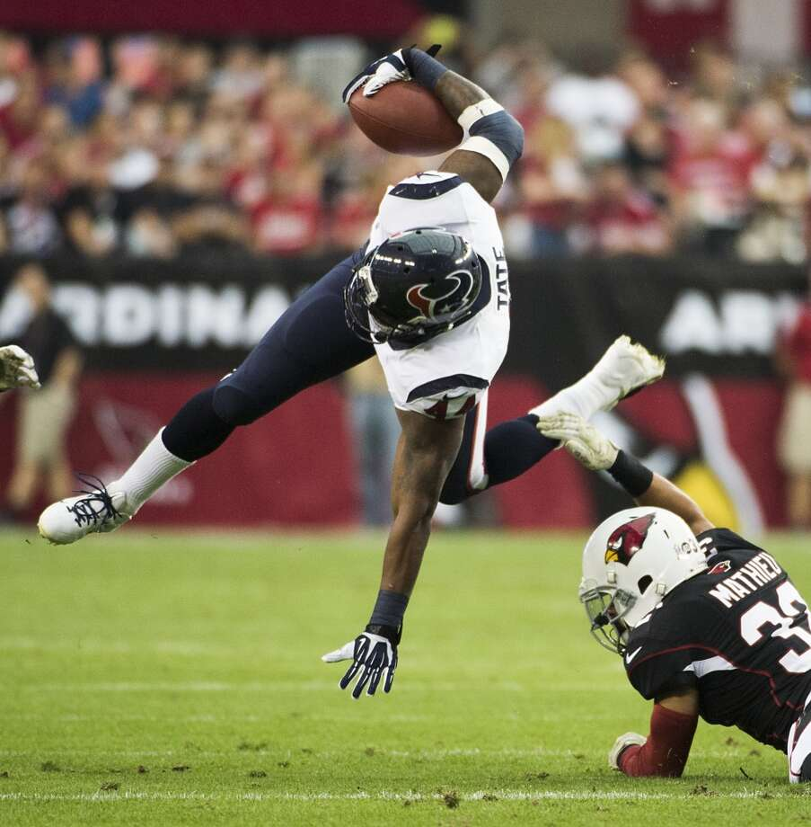 Texans running back Ben Tate is brought down by a Cardinals' defender. Photo: Smiley N. Pool, Houston Chronicle
