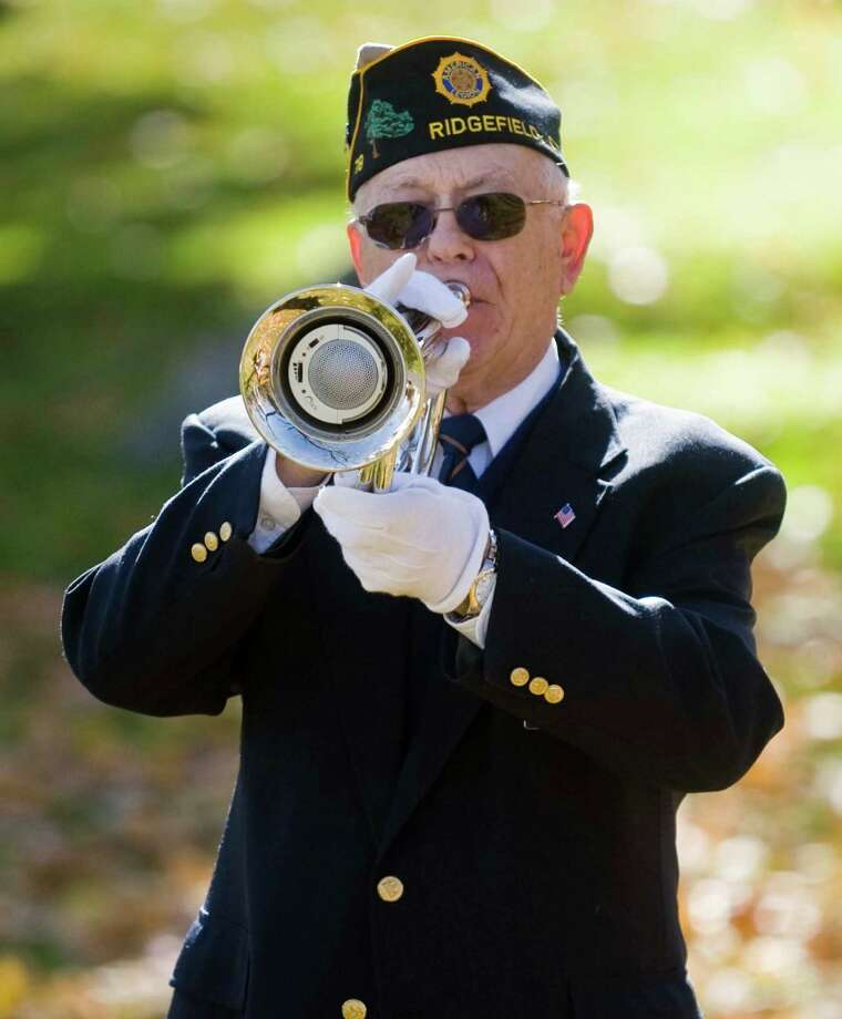Veteran Jack Herr plays Taps during the Veterans Day ceremony at the Ridgefield Community Center. Monday, Nov. 11, 2013 Photo: Scott Mullin / The News-Times Freelance
