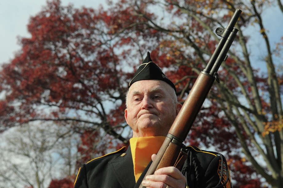 Walt Casey, who served with the Navy during the Korean War, participates in the ceremony as the Greenwich American Legion hosts a Veteran's Day ceremony at the war monument on Greenwich Avenue in Greenwich, Conn., Nov. 11, 2013. Photo: Contributed / Stamford Advocate Freelance
