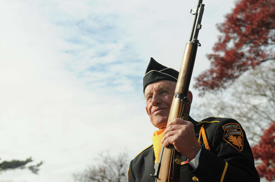 John Zmarzlak, who served with the Navy Seabees during the Korean War, participates in the ceremony as the Greenwich American Legion hosts a Veteran's Day ceremony at the war monument on Greenwich Avenue in Greenwich, Conn., Nov. 11, 2013. Photo: Contributed / Stamford Advocate Freelance