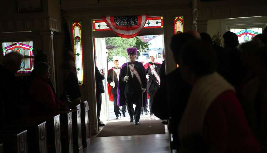 Members of the Knights of Columbus proceed into St Margaret Shrine during the fourth annual Veterans Day Mass in Bridgeport, Conn.  on Monday,  November 11, 2013. Photo: BK Angeletti, B.K. Angeletti / Connecticut Post freelance B.K. Angeletti