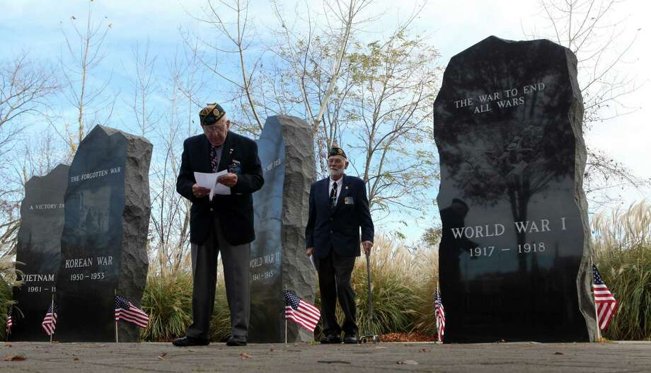 Alphonse Sabetta, left, reads the honor roll at  a Veterans Day ceremony at Veterans Memorial Park in Shelton, on Monday, Nov.11, 213. Walt Bills stands right. Photo: BK Angeletti, B.K. Angeletti / Connecticut Post freelance B.K. Angeletti