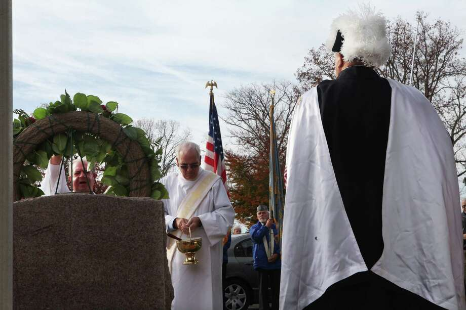 Father Alfonso Picone, a Veteran of the Italian Army, blesses the memorial during the fourth annual Veterans Day Mass at St Margaret Shrine in Bridgeport, Conn.  on Monday,  November 11, 2013. Photo: BK Angeletti, B.K. Angeletti / Connecticut Post freelance B.K. Angeletti