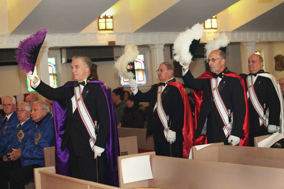 Members of the Knights of Columbus attend the fourth annual Veterans Day Mass at St Margaret Shrine in Bridgeport, Conn.  on Monday,  November 11, 2013. Photo: BK Angeletti, B.K. Angeletti / Connecticut Post freelance B.K. Angeletti