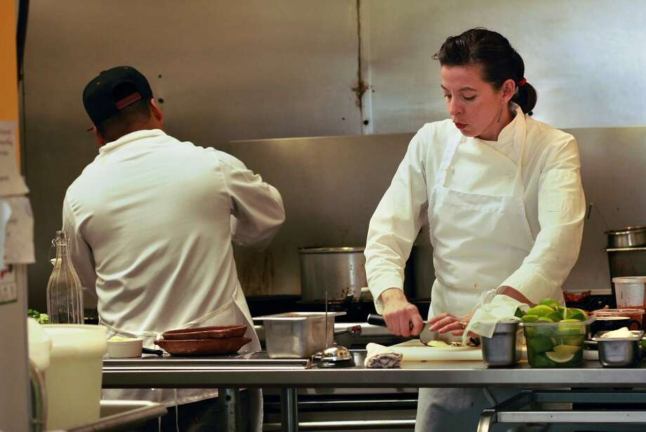 Chef Dominica Rice (right) of Cosecha works in the kitchen. Photo: Liz Hafalia, The Chronicle