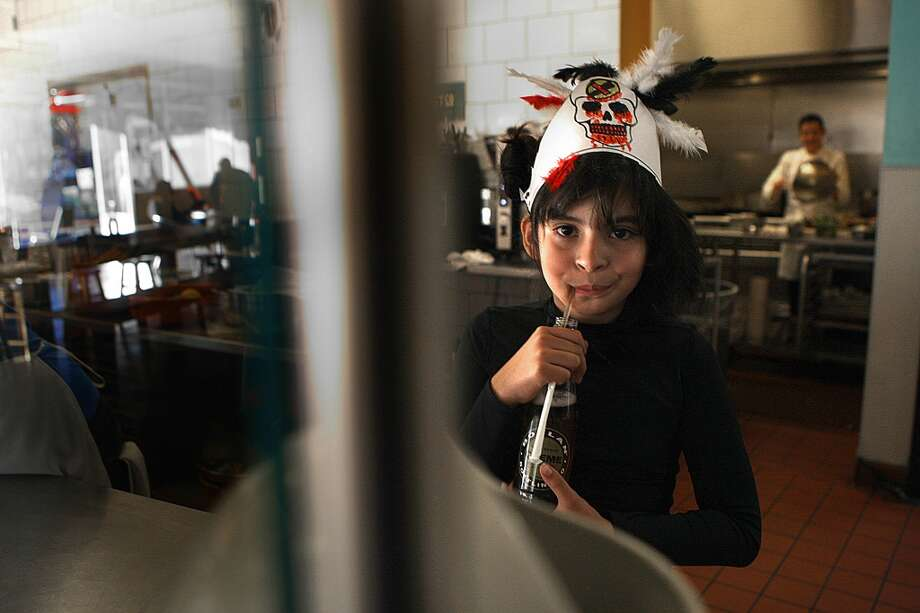 Chef Dominica Rice (back right) of Cosecha is visited by her nine-year-old daughter Xiomora Solomon. Photo: Liz Hafalia, The Chronicle