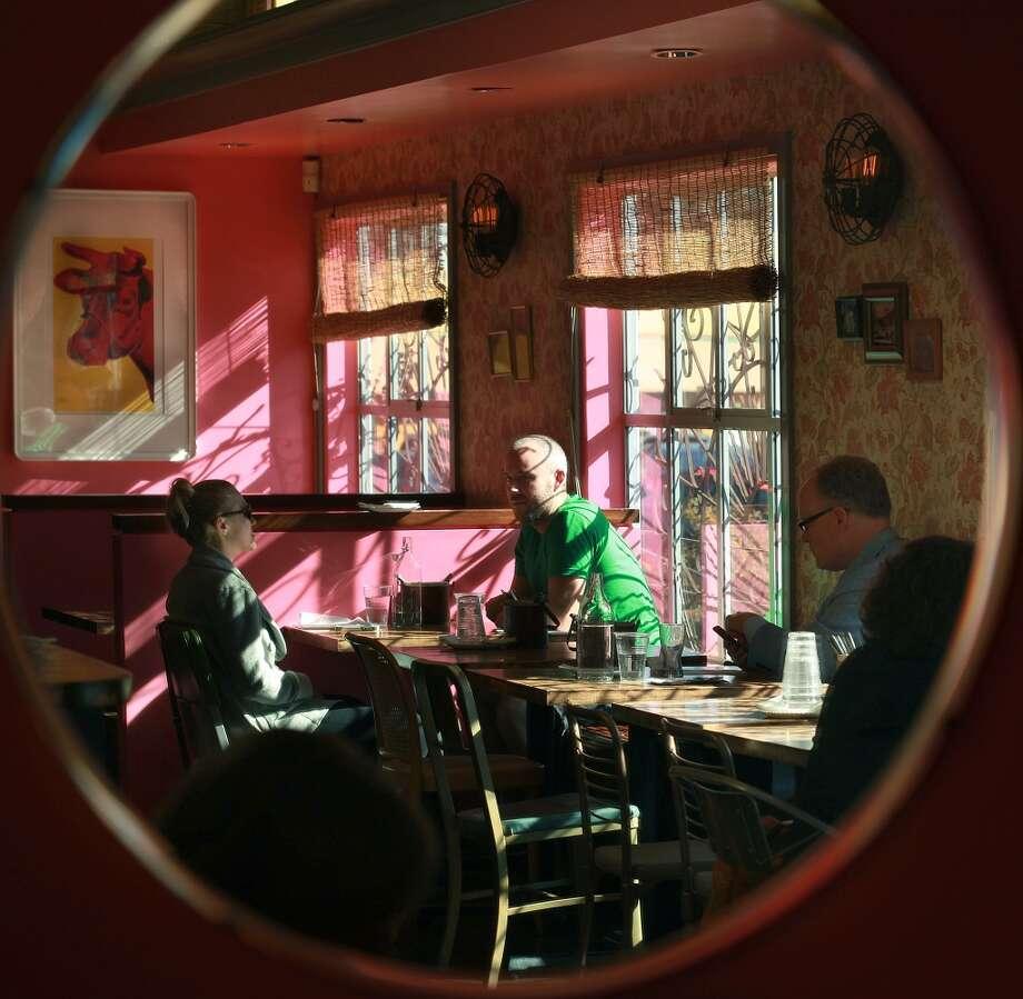 Juhu Beach Club seen in a mirror during the lunch hour. Photo: Liz Hafalia, The Chronicle