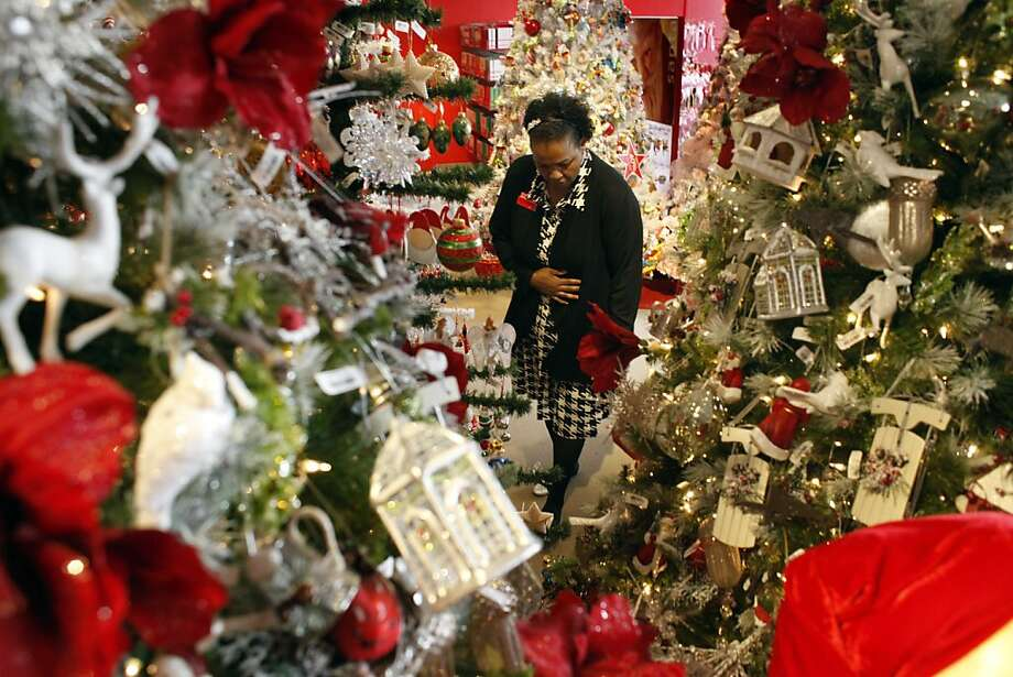 Bridgett Redd, supervisor of the Holiday Lane department at Macy's in S.F., gets ready for shoppers. Photo: Lacy Atkins, The Chronicle
