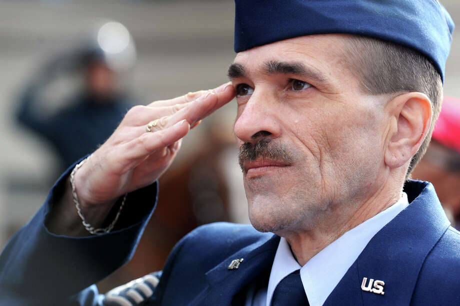 Air Force veteran Philip Rodonski, of Bridgeport, salutes during Veterans Day ceremony held at the Col. Mucci Memorial Green, in Bridgeport, Conn. Nov. 11, 2013. Photo: Ned Gerard / Connecticut Post