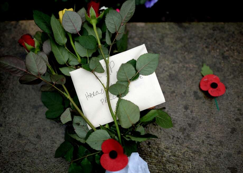 A floral tribute left at the funeral of World War II veteran Harold Percival at Lytham Park Cemetery on November 11, 2013 in Lytham St Annes, England. Hundreds of strangers attended the funeral of former RAF Bomber Command ground crew member, Harold Jellicoe Percival, following an online campaign sparked by a notice placed in a newspaper by the funeral directors. Photo: Nigel Roddis, Getty Images