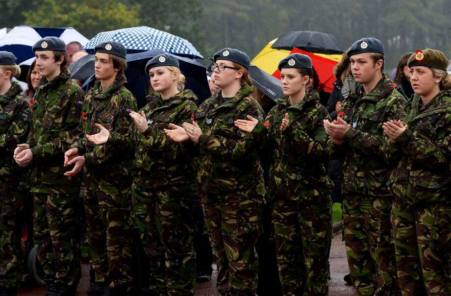 Cadets applaud during the funeral of World War II veteran Harold Percival at Lytham Park Cemetery on November 11, 2013 in Lytham St Annes, England. Hundreds of strangers attended the funeral of former RAF Bomber Command ground crew member, Harold Jellicoe Percival, following an online campaign sparked by a notice placed in a newspaper by the funeral directors. Photo: Nigel Roddis, Getty Images