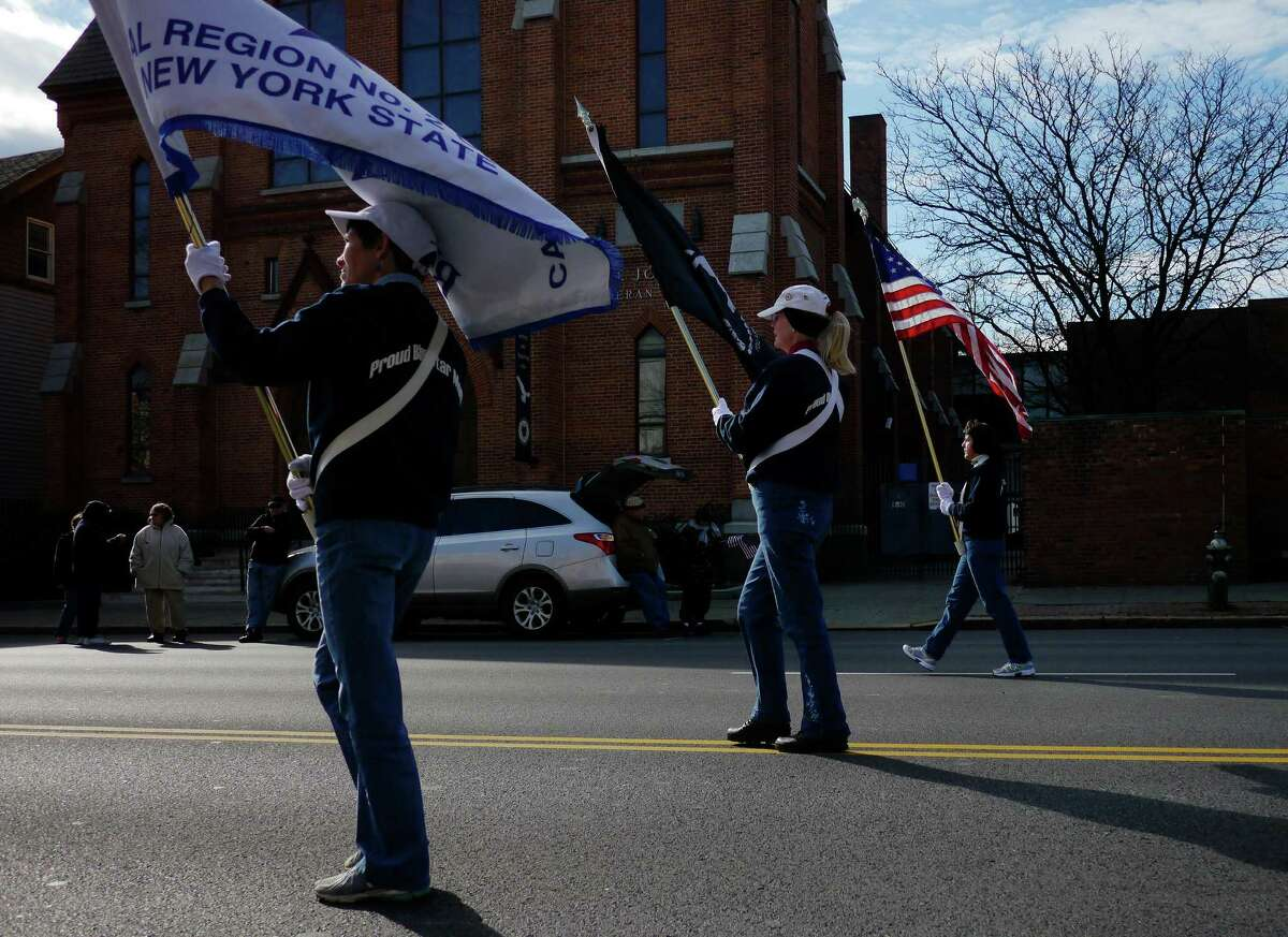 Members of the Blue Star Mothers of America local chapter march down Central Avenue during the Veterans Day Parade on Monday, Nov. 11, 2013 in Albany, NY. (Paul Buckowski / Times Union)