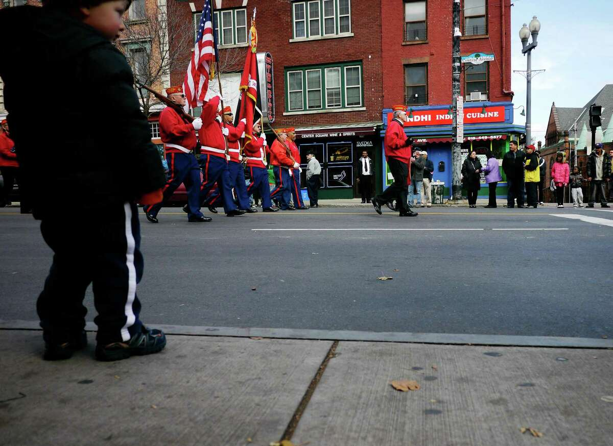Members of the Captain William Dale O'Brien Detachment Marine Corps League march down Central Avenue during the Veterans Day Parade on Monday, Nov. 11, 2013 in Albany, NY. (Paul Buckowski / Times Union)