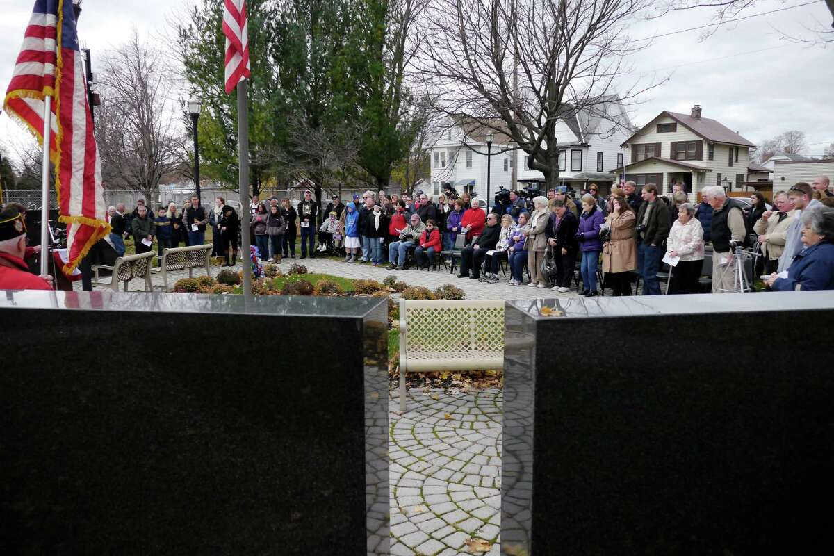 People gather for a Veterans Day ceremony at Veterans Memorial Park on Monday, Nov. 11, 2013 in Watervliet, NY. A total of 42 names were added to the memorial located in the park. (Paul Buckowski / Times Union)