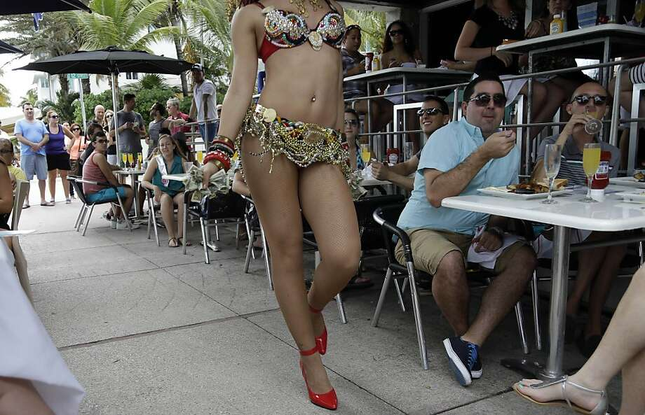 Queen of the Mimosas:At the Palace South Beach restaurant's Sunday brunch in Miami Beach, diners not only tip 