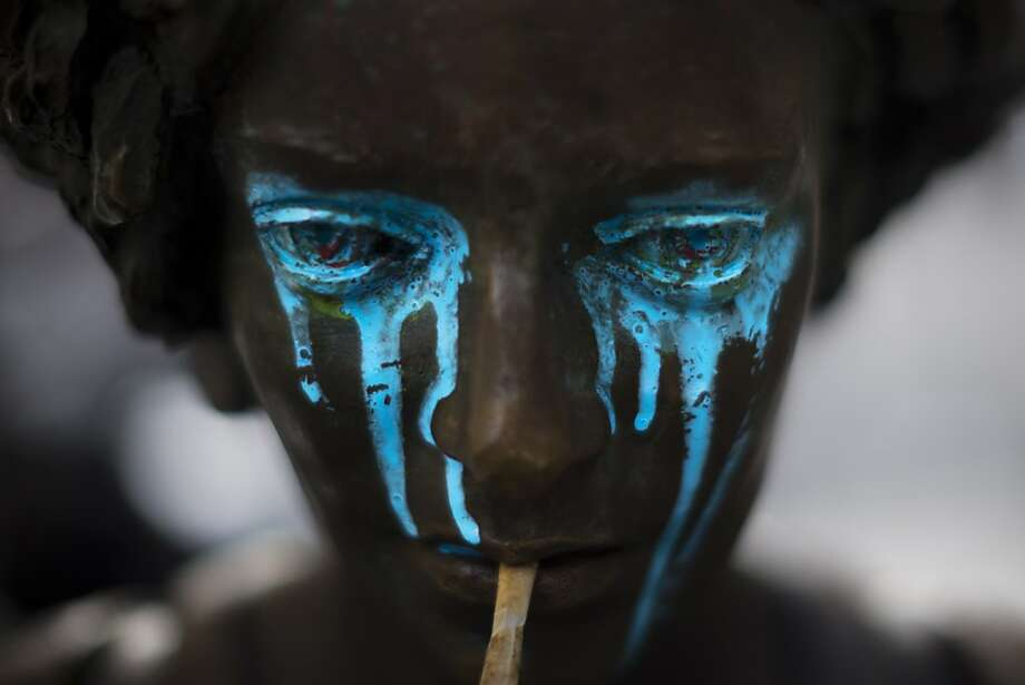 A crying shame: A vandalized statue in Madrid weeps tears of blue paint. Photo: Daniel Ochoa De Olza, Associated Press