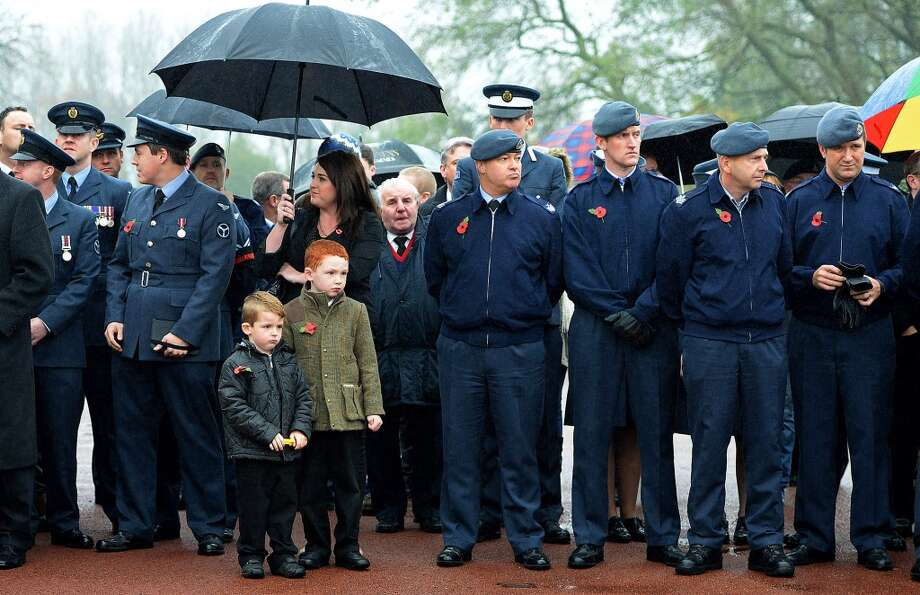 Members of the RAF attend the funeral of World War II veteran Harold Percival at Lytham Park Cemetery on November 11, 2013 in Lytham St Annes, England. Hundreds of strangers attended the funeral of former RAF Bomber Command ground crew member, Harold Jellicoe Percival, following an online campaign sparked by a notice placed in a newspaper by the funeral directors. Photo: Nigel Roddis, Getty Images