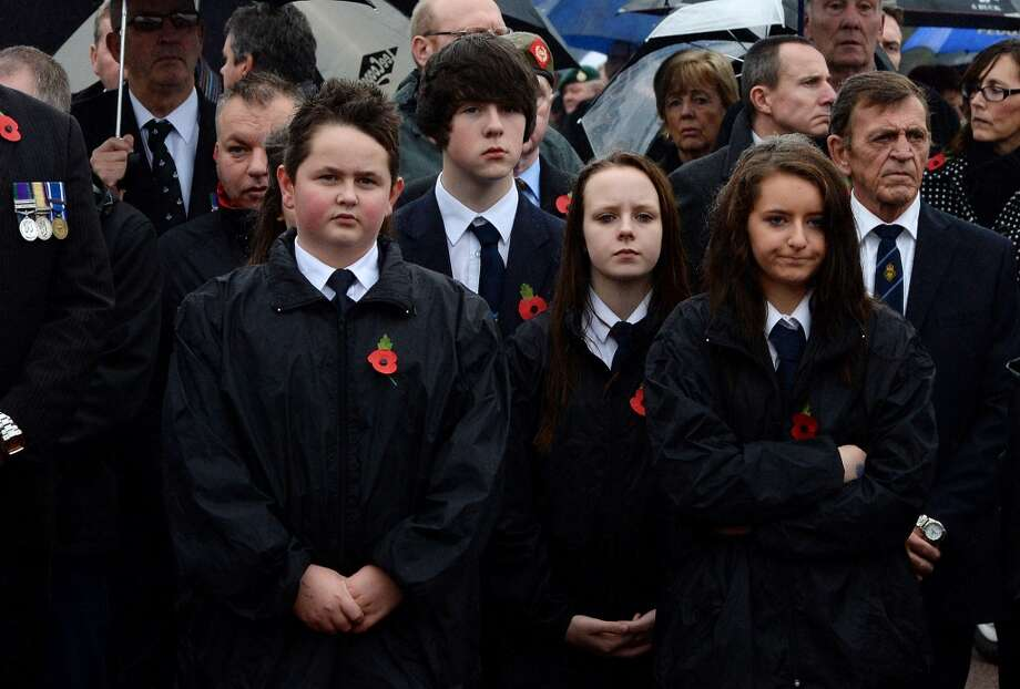 School children attend the funeral of World War II veteran Harold Percival at Lytham Park Cemetery on November 11, 2013 in Lytham St Annes, England. Hundreds of strangers attended the funeral of former RAF Bomber Command ground crew member, Harold Jellicoe Percival, following an online campaign sparked by a notice placed in a newspaper by the funeral directors. Photo: Nigel Roddis, Getty Images