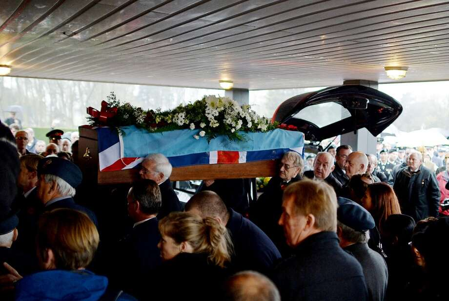 The coffin of World War II veteran Harold Percival is carried into Lytham Park Crematorium on November 11, 2013 in Lytham St Annes, England. Hundreds of strangers attended the funeral of former RAF Bomber Command ground crew member, Harold Jellicoe Percival, following an online campaign sparked by a notice placed in a newspaper by the funeral directors. Photo: Nigel Roddis, Getty Images