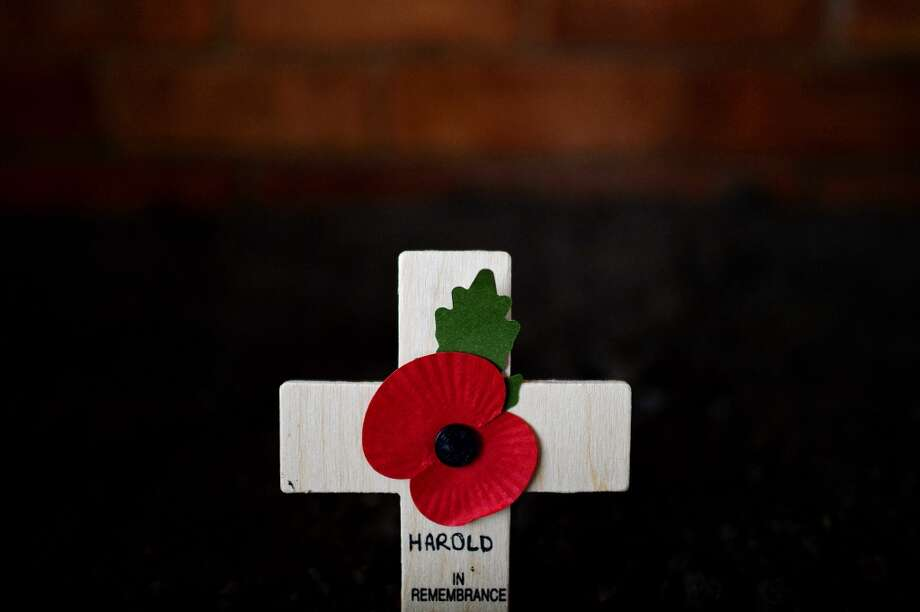 A lone cross adorned with a poppy is seen at the funeral of World War II veteran Harold Percival at Lytham Park Cemetery on November 11, 2013 in Lytham St Annes, England. Hundreds of strangers attended the funeral of former RAF Bomber Command ground crew member, Harold Jellicoe Percival, following an online campaign sparked by a notice placed in a newspaper by the funeral directors. Photo: Nigel Roddis, Getty Images