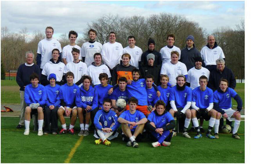 Past and present Darien High School soccer players pose for a picture prior to the start of the 2012 alumni game. Photo: Contributed Photo / Darien News