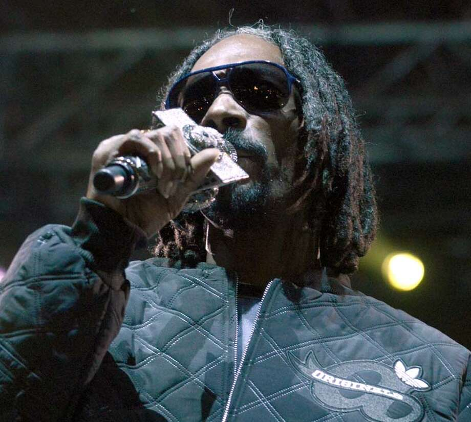 Snoop Dogg aka Snoop Lion performs as part of the Fun Fun Fun Festival at Auditorium Shores on November 8, 2013 in Austin, Texas. (Photo by Tim Mosenfelder/Getty Images) Photo: Tim Mosenfelder, Getty Images / 2013 Tim Mosenfelder