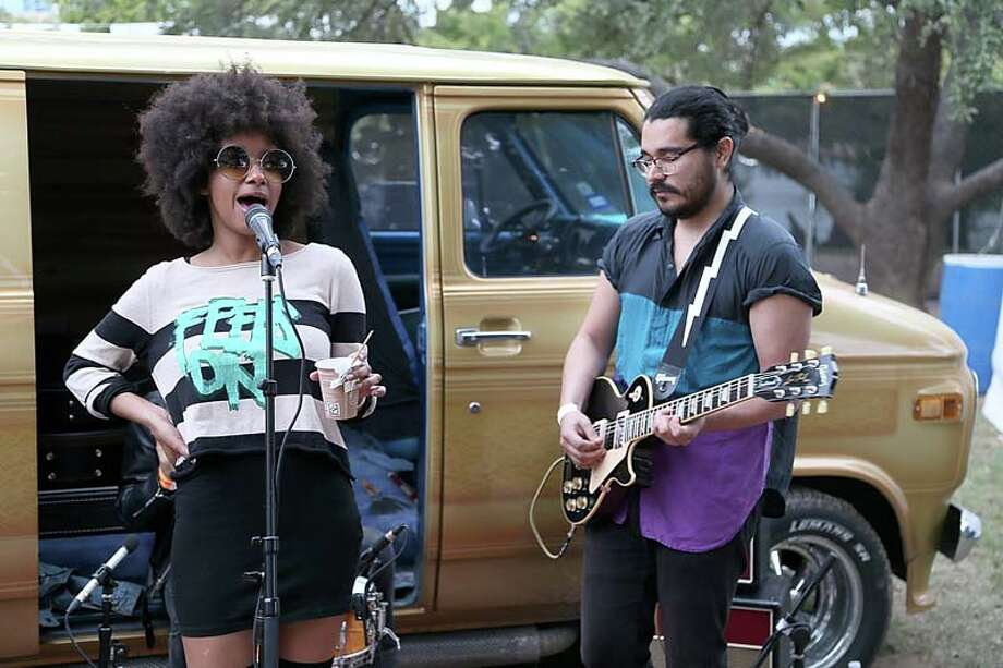 Asli Omar (L) and Adam Martinez of The Tontons pose backstage during Fun Fun Fun Fest at Auditorium Shores on November 9, 2013 in Austin, Texas.  (Photo by Gary Miller/FilmMagic) Photo: Gary Miller, FilmMagic / 2013 Gary Miller