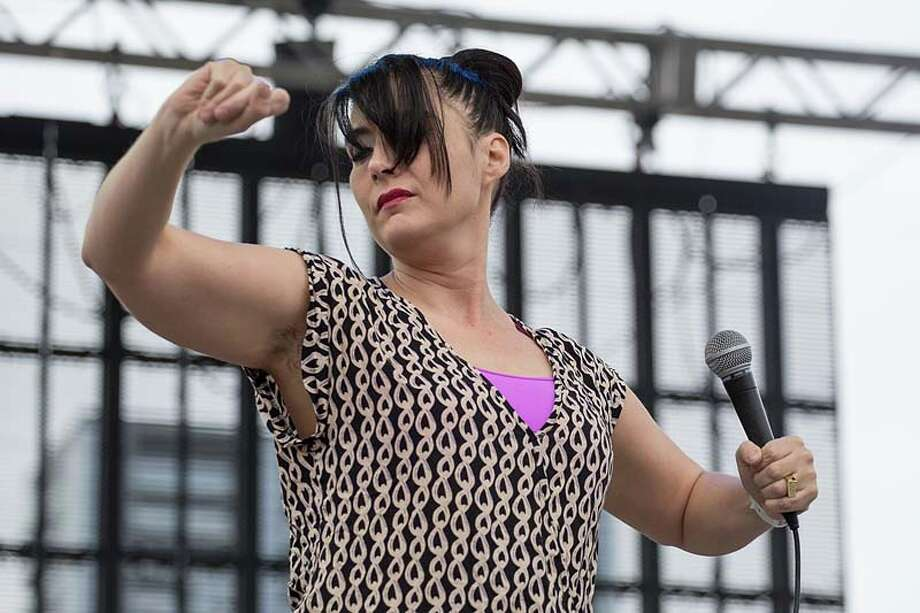 Musician/vocalist Kathleen Hanna of The Julie Ruin performs on stage during Day 3 of Fun Fun Fun Fest at Auditorium Shores on November 10, 2013 in Austin, Texas.  (Photo by Rick Kern/Getty Images) Photo: Rick Kern, Getty Images / 2013 Rick Kern