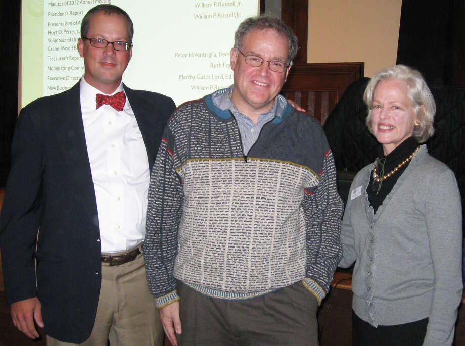 Several volunteers were honored at Pequot Library's annual meeting. From left,  William Russell, president of the board of trustees; volunteer Doug Fried who was honored for his years of service to the Pequot Library book sale; and Pequot  Executive Director Martha Lord. Photo: Contributed Photo / Fairfield Citizen