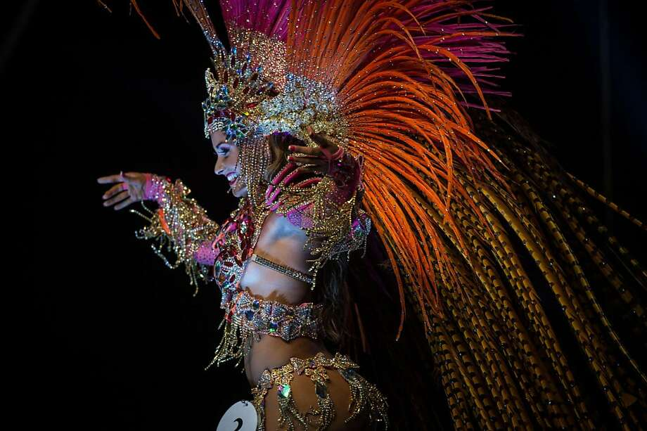 Better luck next year: Hoping to be named queen of Rio de Janeiro's Samba Carnival, a costumed dancer performs on stage during the selection process. She didn't win. Photo: Yasuyoshi Chiba, AFP/Getty Images