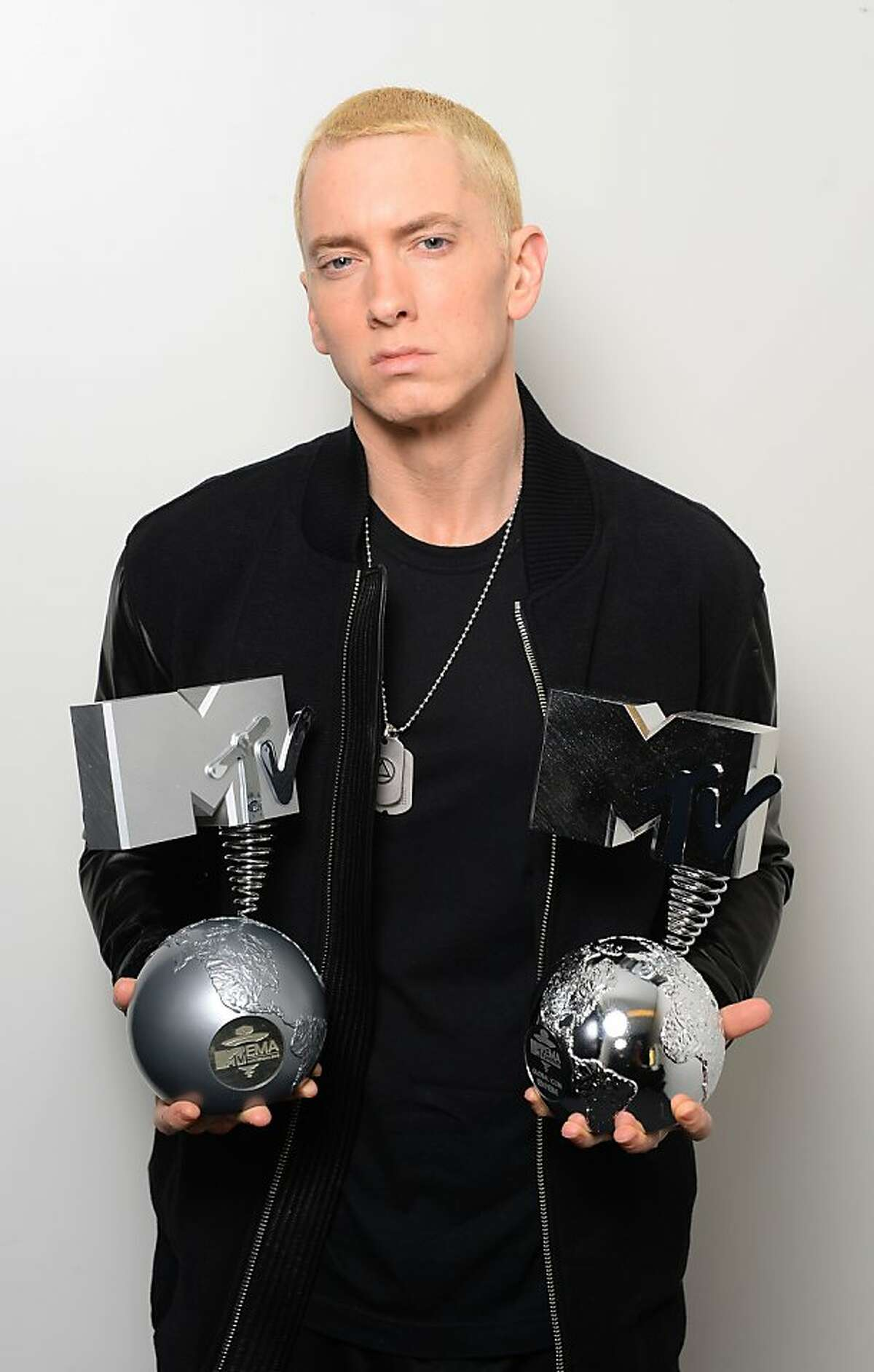Obviously one of the happiest days of his life: Eminem is overcome with excitement after winning the Best Hip Hop and Global Icon awards during the MTV EMAs in Amsterdam.