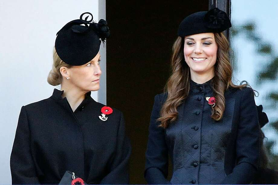 Mirror, mirror on the wall ... Even though she's wearing the weirder hat, Sophie, Countess of Wessex, can't compete with Kate's glowing smile at a wreath-laying ceremony in London. Britain honored veterans of the two World Wars and subsequent conflicts. Photo: Matthew Lloyd, Getty Images