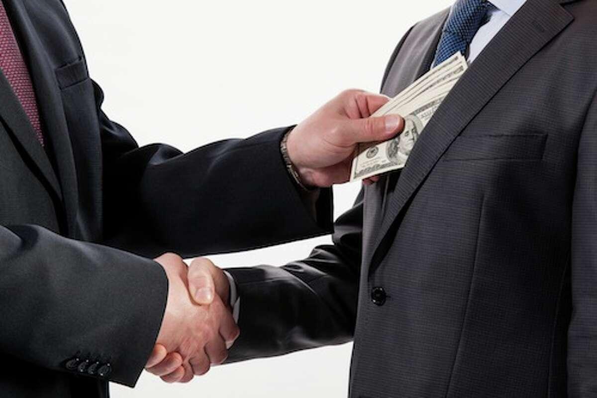 Giving a bribe into a pocket - closeup shot