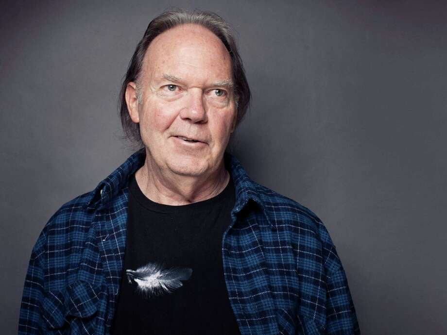 "This Sept. 27, 2012 photo shows singer-songwriter Neil Young posing for a portrait at The Carlyle hotel in New York. Young has released his first book, a memoir titled, ""Waging Heavy Peace."" (Photo by Victoria Will/Invision/AP) Photo: Victoria Will / Invision"
