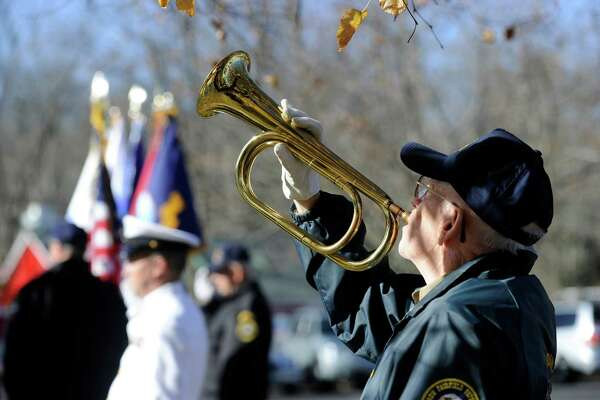 """Stanley """"Red""""  Britton, 80, of Danbury, plays Taps during New Fairfield's Veterans Day Ceremony Monday. The town of New Fairfield, Conn. recognized Veterans Day with a ceremony at Veterans Green that included the dedication of a monument honoring Staff Sgt. Todd """"T.J."""" Lobraico and other town residents killed in action, Monday. Nov. 11, 2013.  Lobraico, serving in Afghanistan, died Sept. 5."""