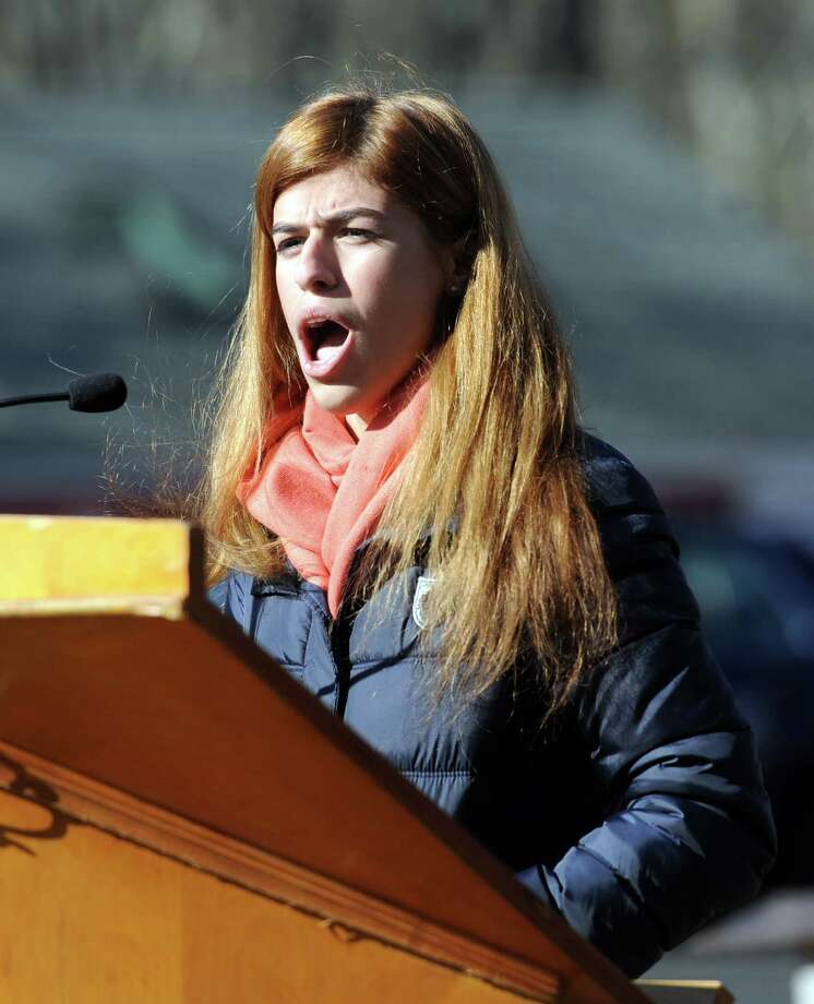 "Despina Drougas sings the National Anthem at a Veterans Day ceremony Monday. The town of New Fairfield, Conn. recognized Veterans Day with a ceremony at Veterans Green that included the dedication of a monument honoring Staff Sgt. Todd ""T.J."" Lobraico and other town residents killed in action, Monday. Nov. 11, 2013.  Lobraico, serving in Afghanistan, died Sept. 5. Photo: Carol Kaliff / The News-Times"