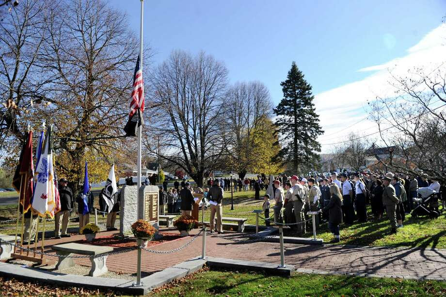 "The town of New Fairfield, Conn. recognized Veterans Day with a ceremony at Veterans Green that included the dedication of a monument honoring Staff Sgt. Todd ""T.J."" Lobraico and other town residents killed in action, Monday. Nov. 11, 2013.  Lobraico, serving in Afghanistan, died Sept. 5. Photo: Carol Kaliff / The News-Times"