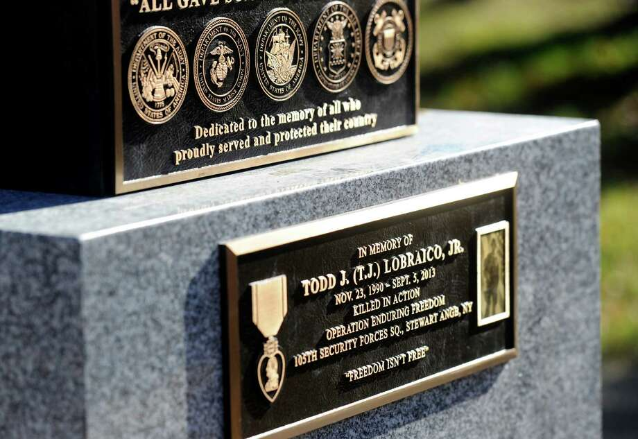 "The town of New Fairfield, Conn. recognized Veterans Day with a ceremony at Veterans Green that included the dedication of monument honoring Staff Sgt. Todd ""T.J."" Lobraico and other town residents killed in action, Monday. Nov. 11, 2013.  Lobraico, serving in Afghanistan, died Sept. 5. Photo: Carol Kaliff / The News-Times"