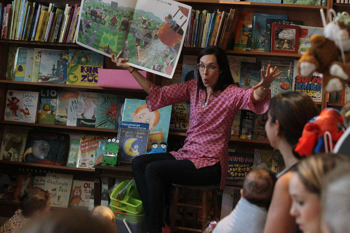 Anastasia McKenna, known as Miss Anastasia, gets animated while reading to children (and their parents) at The Twig Book Shop. Making faces and taking on the voice of characters in a story