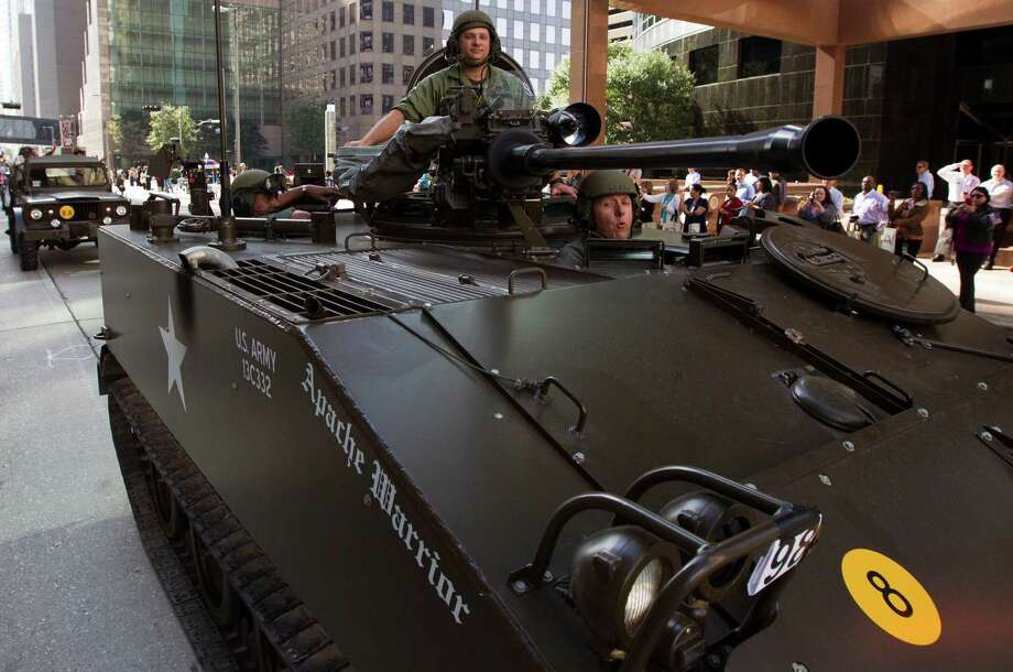 An Army tank drives through downtown during the annual City of Houston Veterans Day parade on Monday, Nov. 11, 2013, in Houston.  The celebration also included a Veterans job and health fair. Photo: J. Patric Schneider, For The Chronicle / © 2013 Houston Chronicle