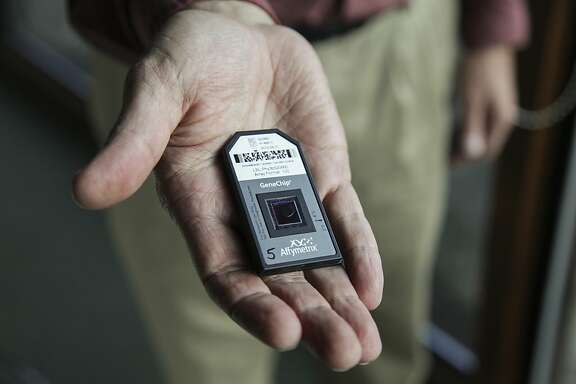 Gary Andersen, a UC Berkeley and Lawrence Berkeley National Lab scientist, shows a PhyloChip, a device which allows for the identification of various types of bacterial and archaeal organisms at the ranch of John Wick in Nicasio on October 31st 2013. Andersen used this chip, which he helped invent, in a study to look at how to create the ideal conditions for composting solid waste so that it can be used for agriculture.