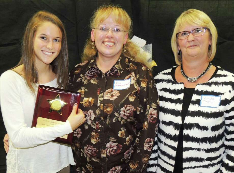 Abby Fernandez of Westport receives ther Youth Volunteer of the Year Award from Jill Schreckengost, manager of Recreational Programs at STAR, and Linda Snell, director of Family Services at STAR. Photo: Contributed Photo / Westport News