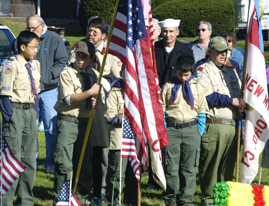 Boy Scouts and their leaders are deep in thought as prayers are said during New Milford's Veterans Day ceremony on the south end of the Village Green in New Milford. Nov. 11, 2013 Photo: Norm Cummings / The News-Times