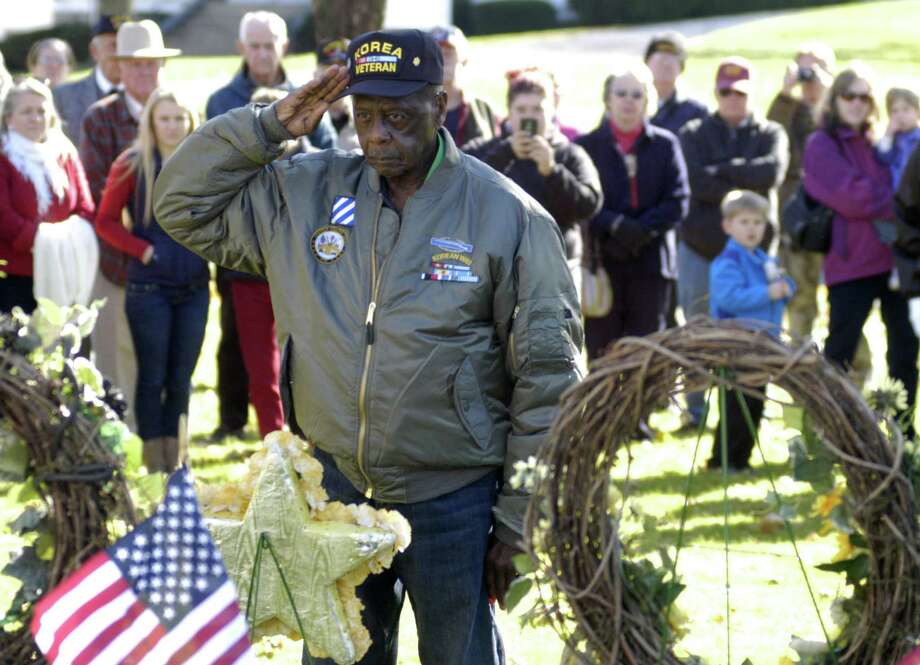 Korean War veteran Herman Izzard extends a solemn salute during New Milford's Veterans Day ceremony on the south end of the Village Green in New Milford. Nov. 11, 2013 Photo: Norm Cummings / The News-Times